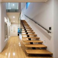 Wholesale Modern villa stair design Free design acasia wood staircase with frameless glass  railing from china suppliers