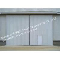 Buy cheap Sectional Horizontal Industrial Sliding Doors With Access Pedestrian Door For Workshop from wholesalers