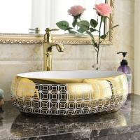 Buy cheap Bathroom luxury modern design golden ceramic oval electroplated wash art basin bowl for wholesale in mid east market from wholesalers
