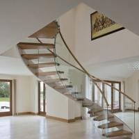 Buy cheap American building unique design Modern Curved stainless steel rod railing Wood Stairs arc stairs with metal rails from wholesalers