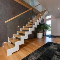 Wholesale Fordable lobby staircase in steel stringer glass handrail design from china suppliers