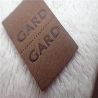 Buy cheap Embossed Leather Woven Label With Dashed Points Convenient To Mid Fold from wholesalers