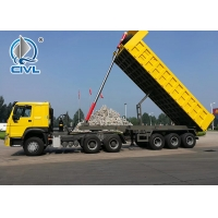 Buy cheap NEW 12 TIRES Heavy Duty Side 3 Axles 60 - 80 Tons Semi Trailer Dump Truck SINOTRUK from wholesalers