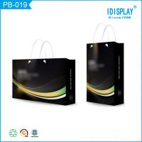 China Personalized Black Glossy Finish Paper Shopping Bags With Handles , Logo Printed on sale