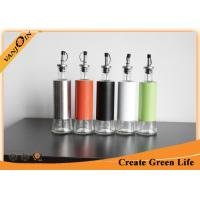 Buy cheap Kitchen Use 10oz Glass Oil Bottle With Plastic Cover And Stainless Steel Nozzle from wholesalers