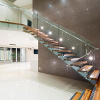 Wholesale Modern villa stair design mono beam acasia wood staircase with frameless glass railing from china suppliers