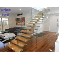 interior wooden staircase design with frameless glass railing Manufactures