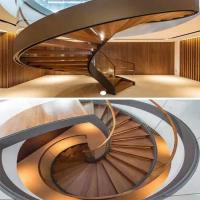 Buy cheap Decorative stainless steel beam closed riser interior round curved stairs with glass railing from wholesalers